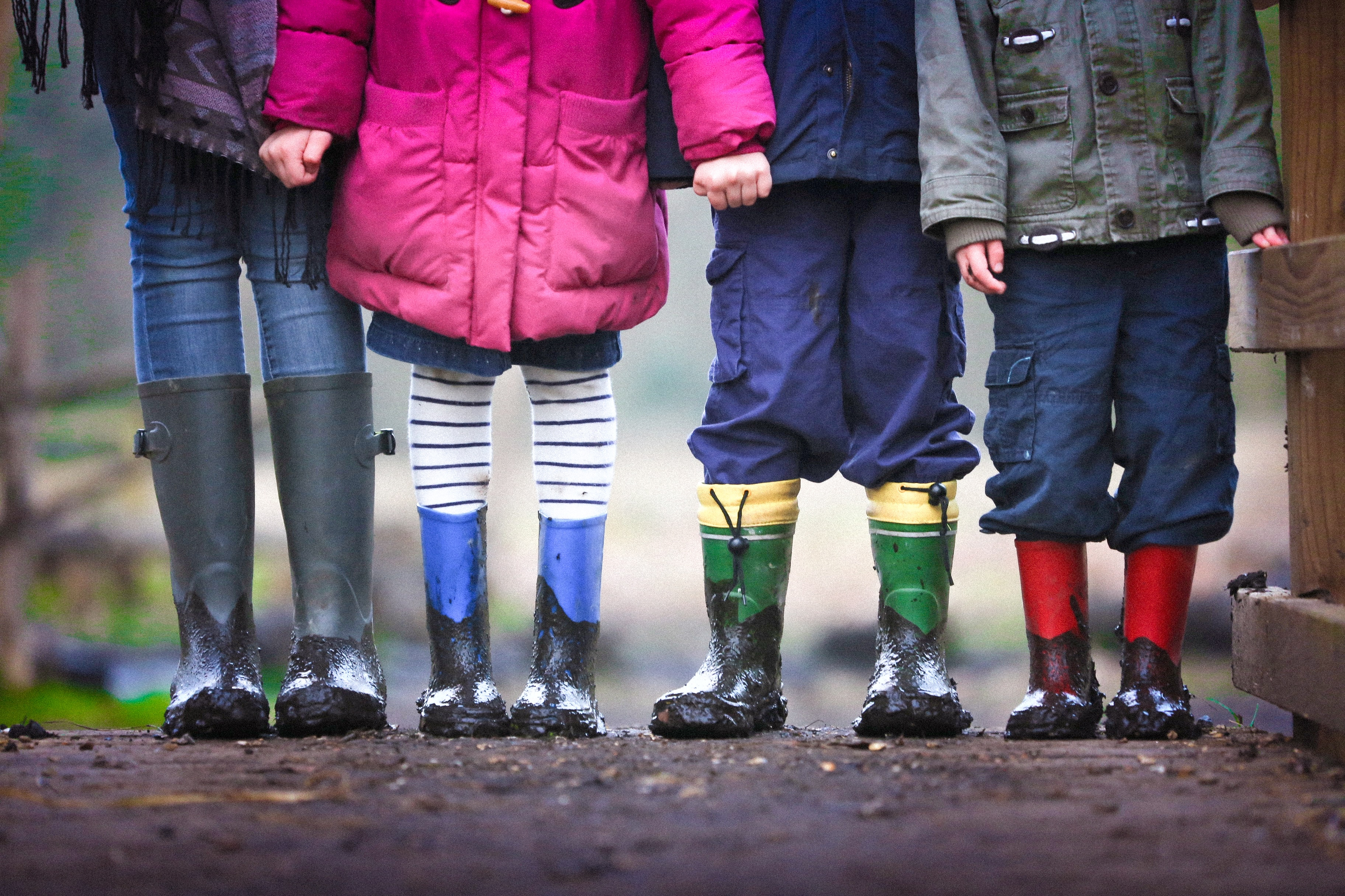 Kids in rain boots standing together