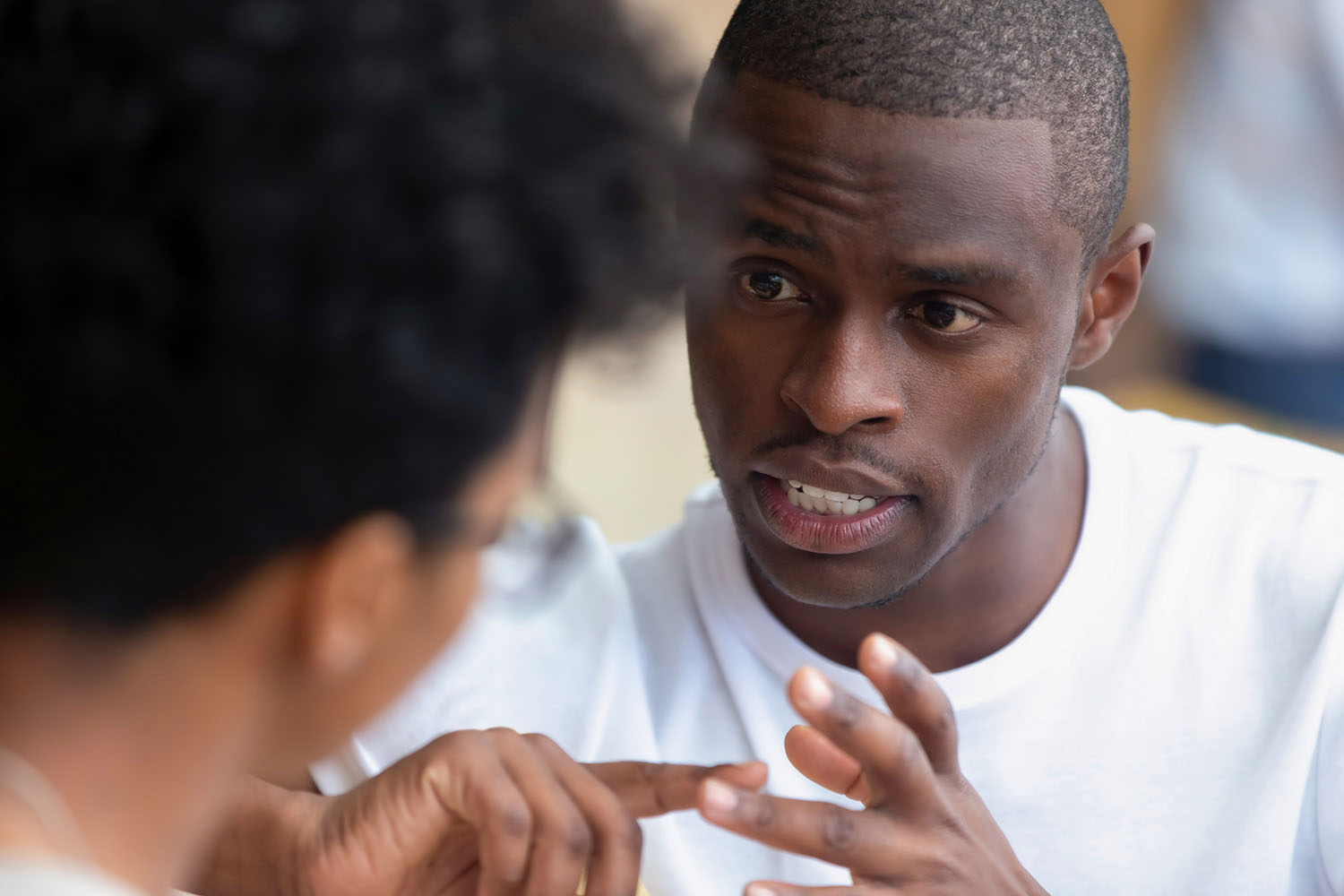 Picture of a man explaining something to another man