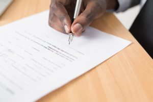 A man about to sign a contract