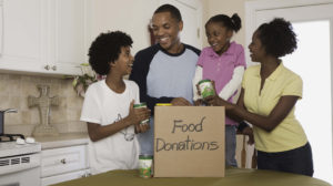 A family exciting about donating food