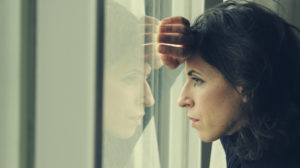 Sad woman looking out a window