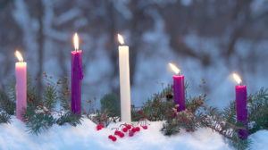 Lit candles in the snow