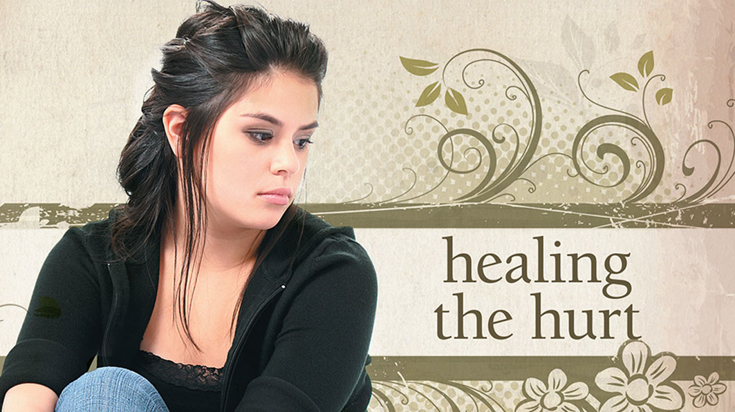 A contemplative woman thinking about her hurt over a past abortion