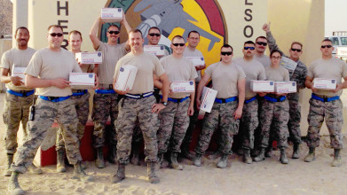 Honor and Support to our troops is seen as several service men and women are in the picture with packages that were sent to them.