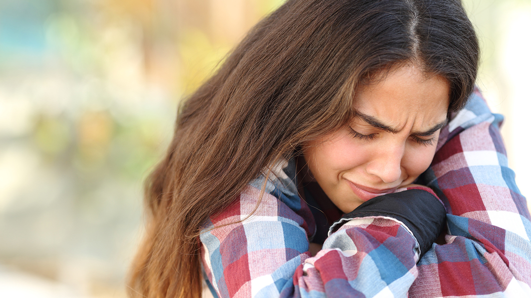 Living with healthy grief. Teen girl crying
