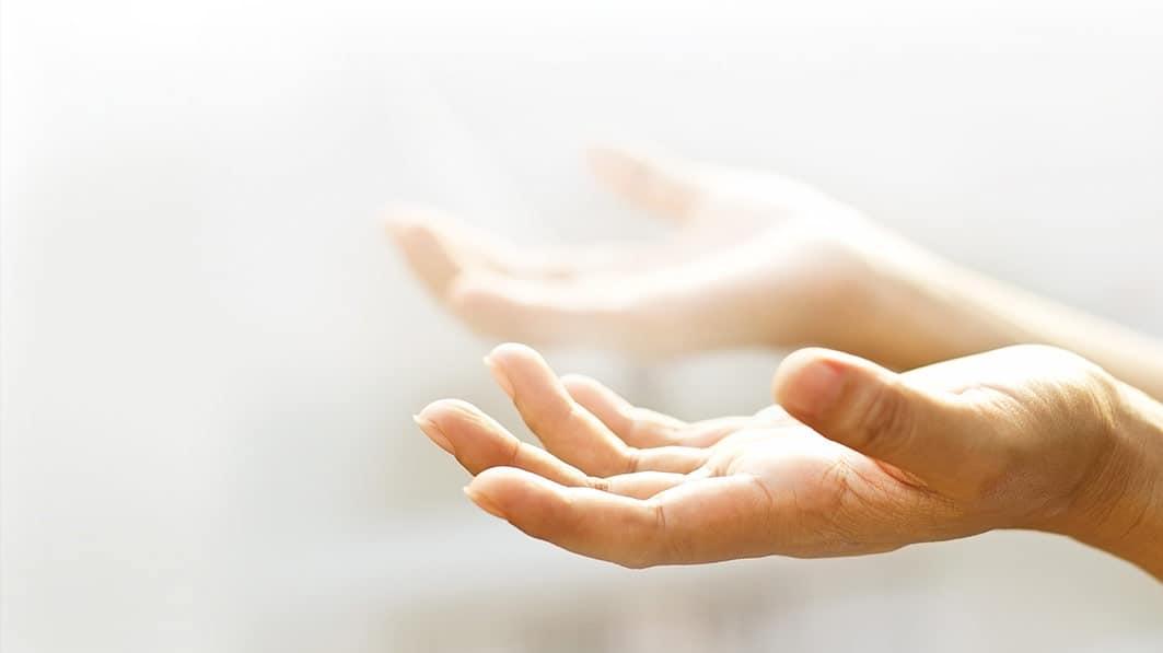 hands facing upward in prayer