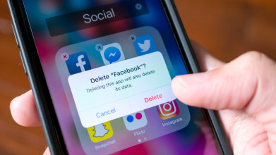 Facebook user deleting Facebook application on cell phone