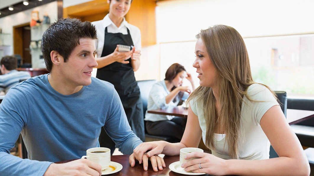 Husband and wife engage in positive communication at a cafe