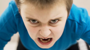 Close up of angry young boy's face