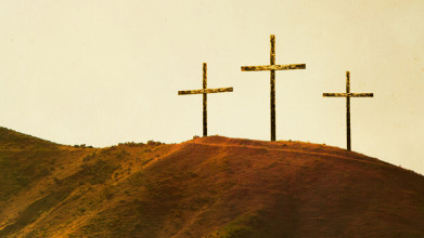 Three crosses on top of a hill