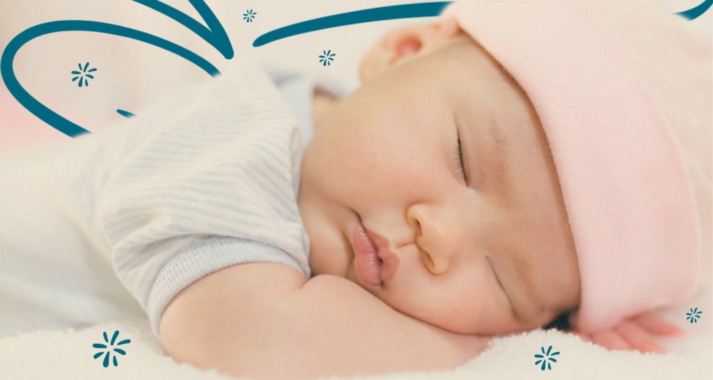 Taking Care of a Newborn: Close up of a cute, baby Asian girl sleeping on her stomach with her head resting on her forearms