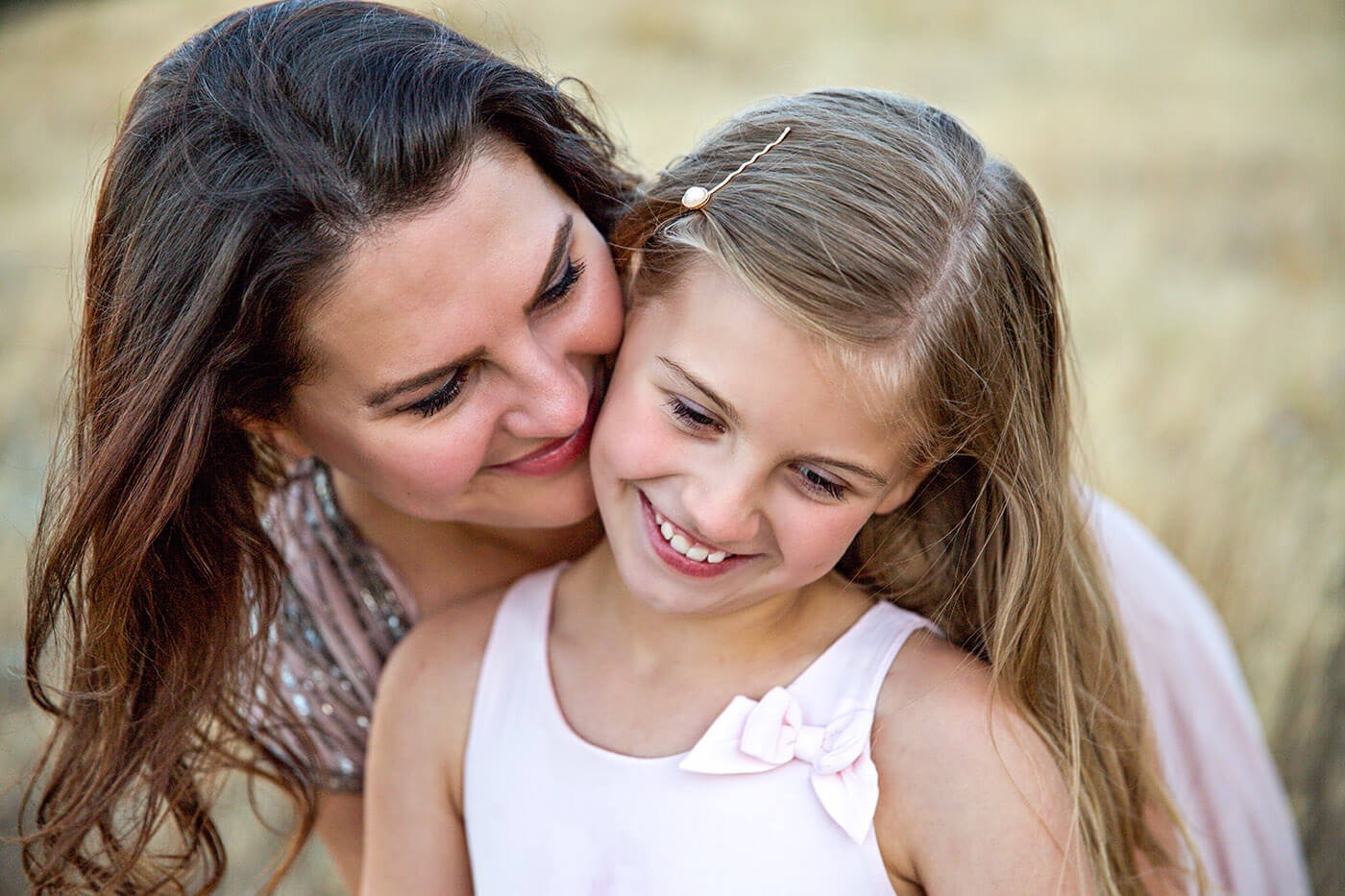 Raising healthy resilient kids through love as seen by mom hugging daughter