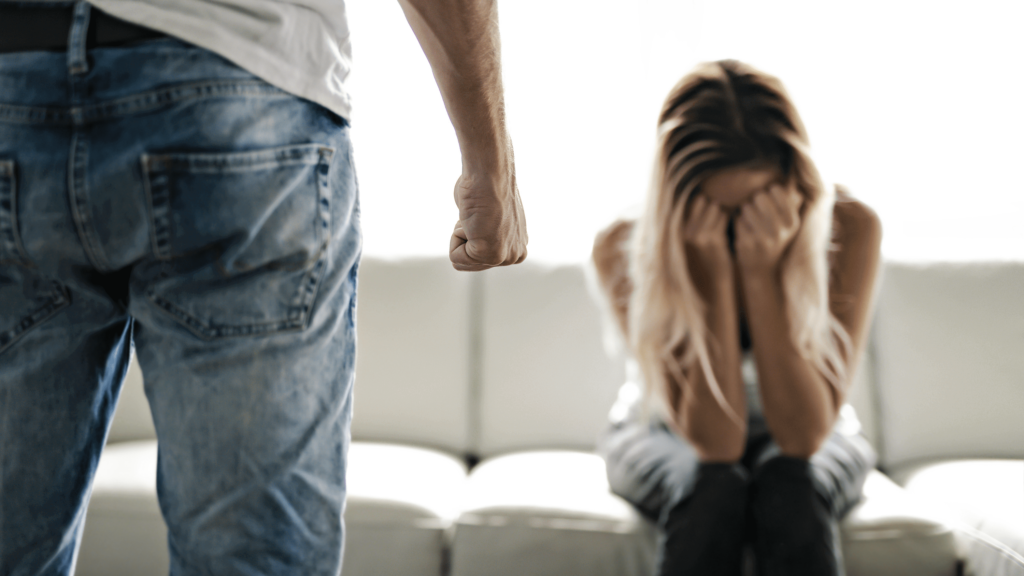 domestic violence husband fist wife crying