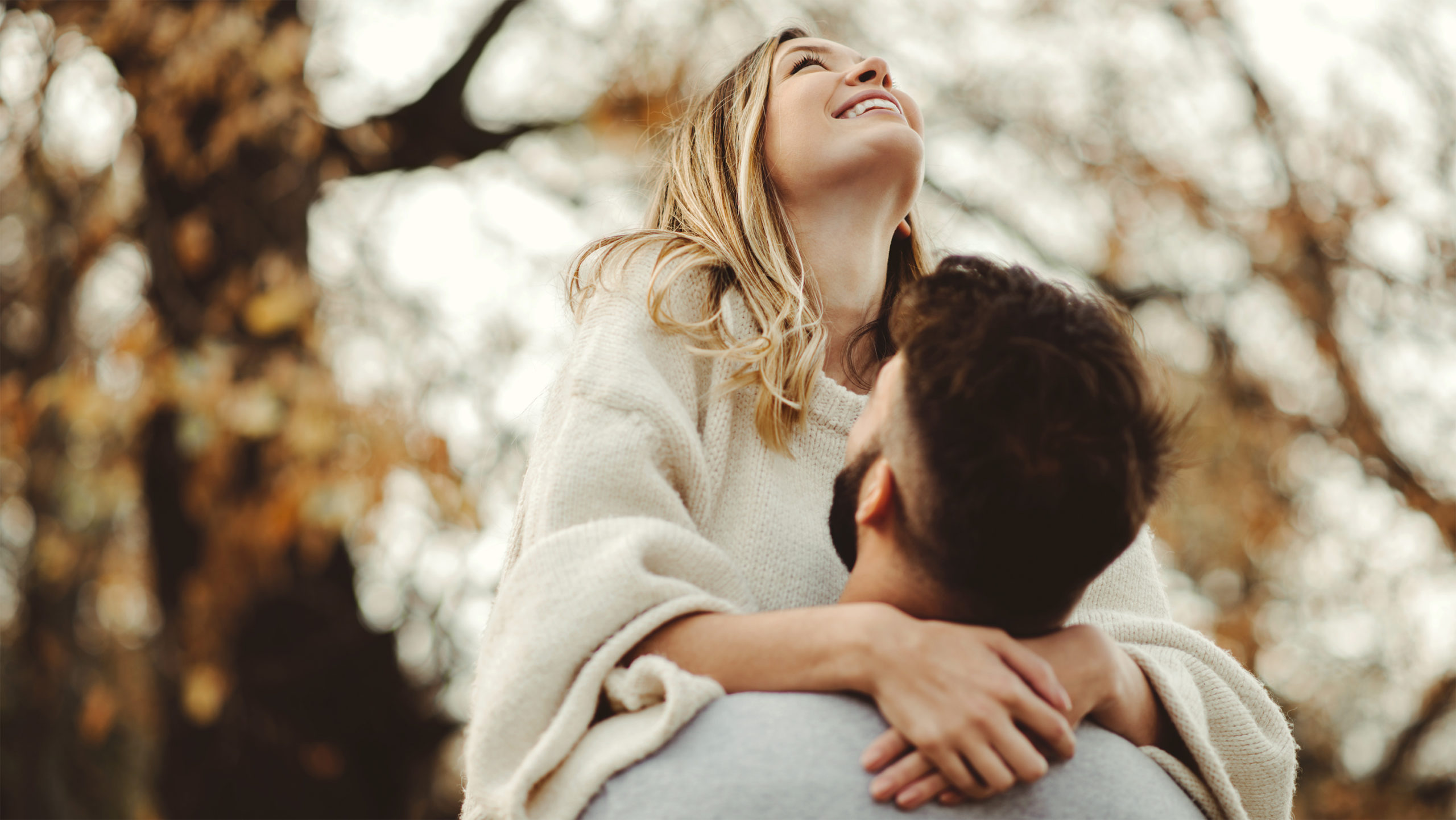 Husband picking up wife demonstrating love is patient and kind