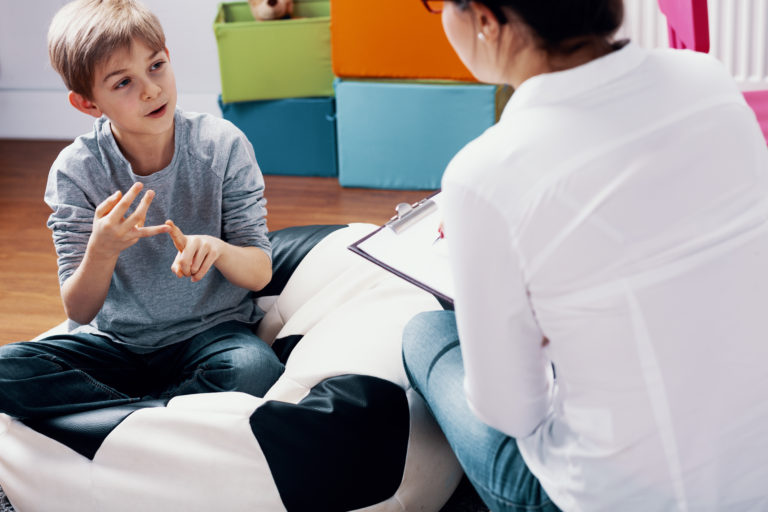 Child talking with counselor