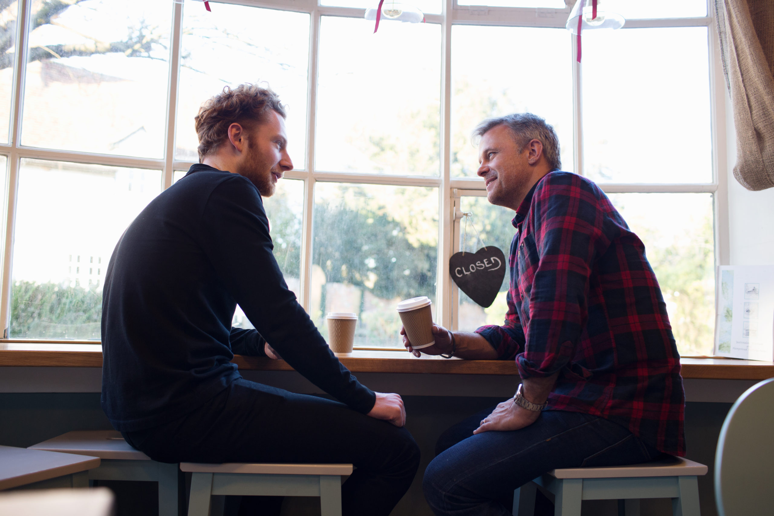 two men sitting in a coffee shop