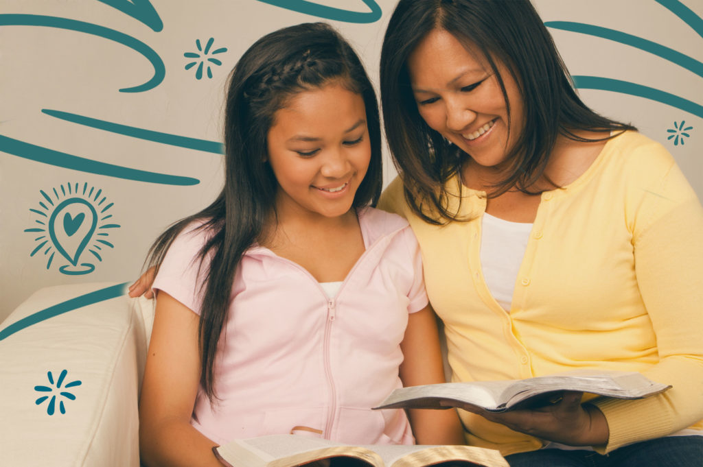 Mom teaching daughter to read the Bible
