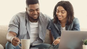 African American couple planning budget