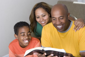 foster family reading the bible