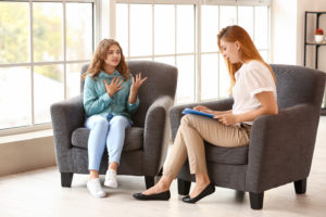 Caseworker with teen in foster care