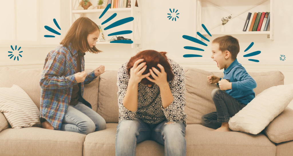 Two kids fighting with tired mom sitting in between them