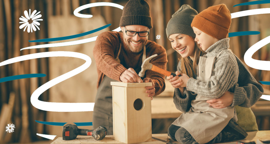 Family building a birdhouse together