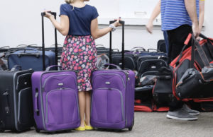 Child in foster care with donated suitcases