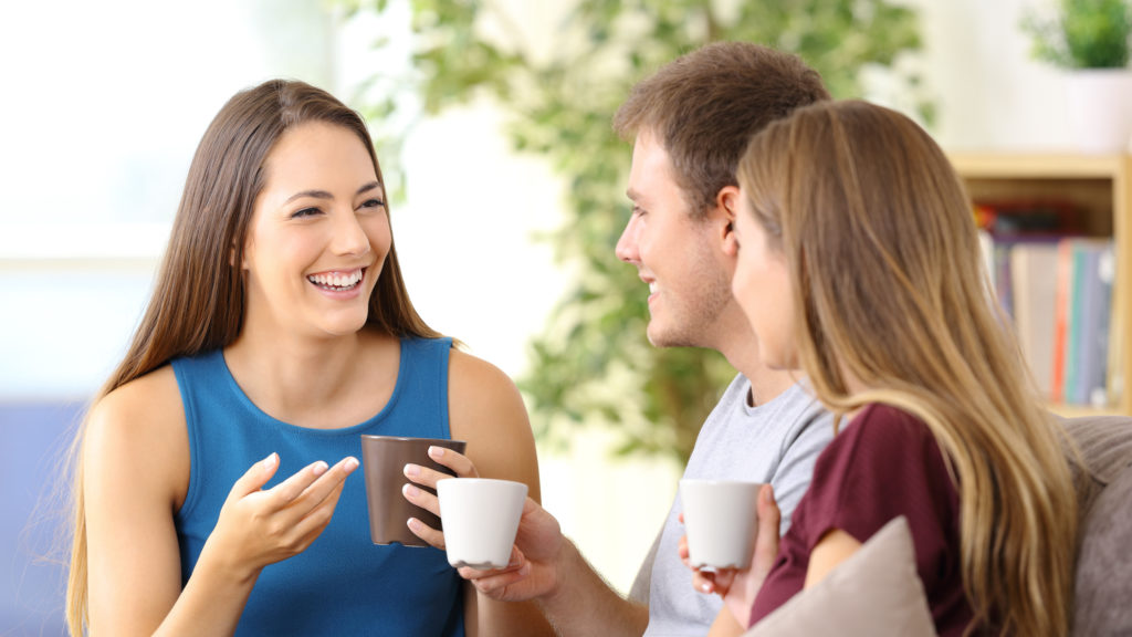 three-people-talking-and-drinking-coffee