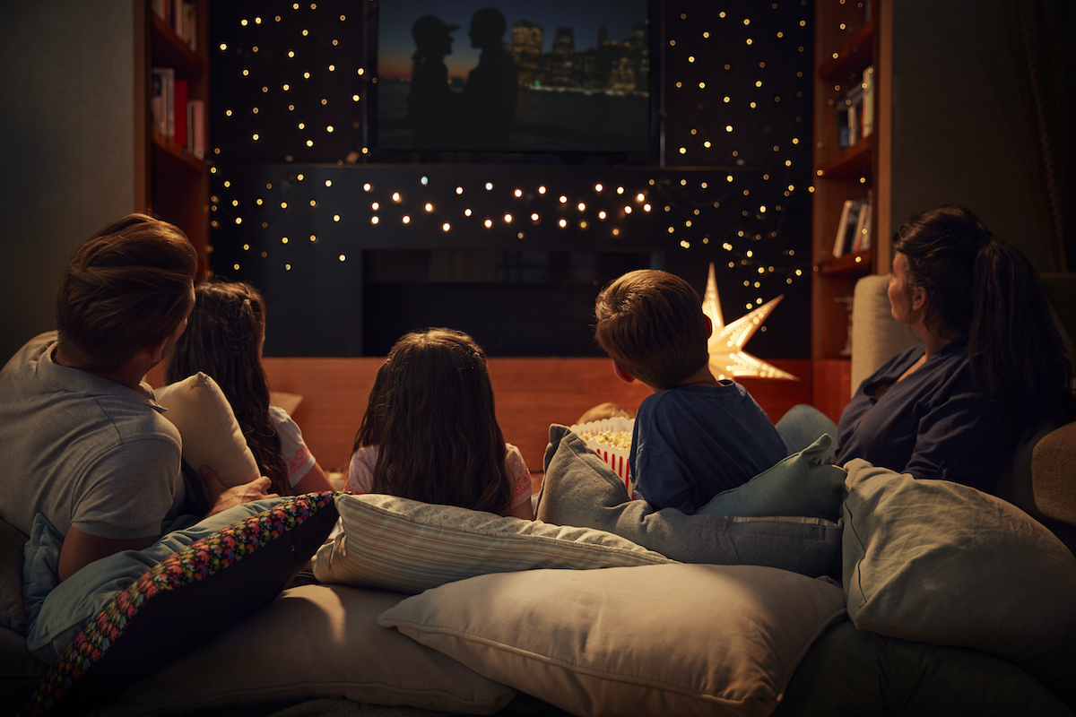 A family gathered as they watch a pro life movie and talk about books