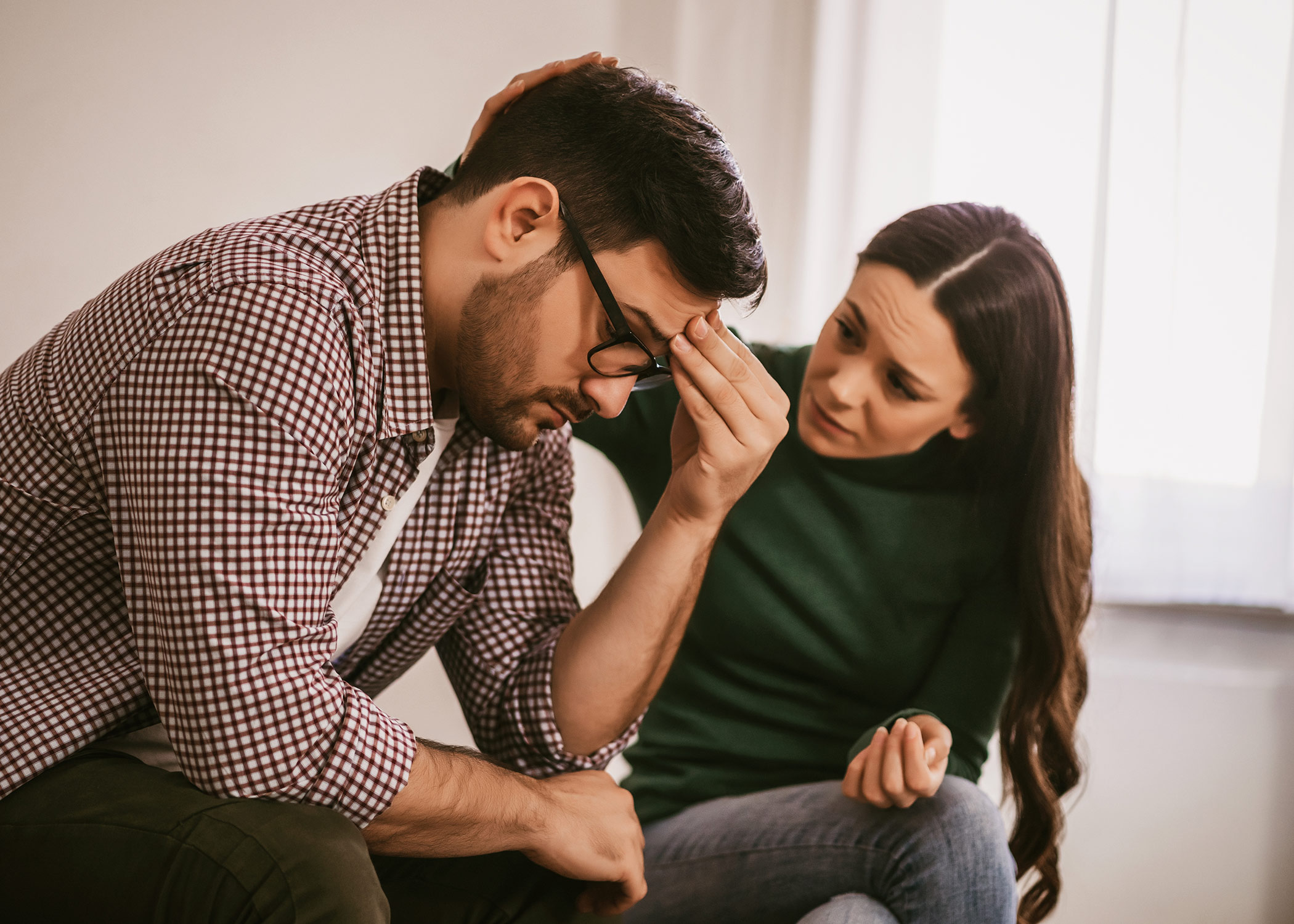 Man has mental health issues, his wife is consoling him.